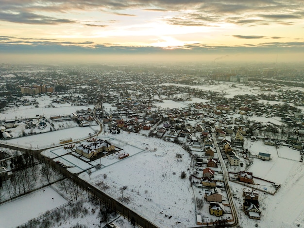 Top view of city suburbs or small town nice houses on winter morning