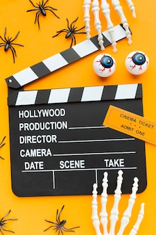 Top view clapperboard with halloween elements