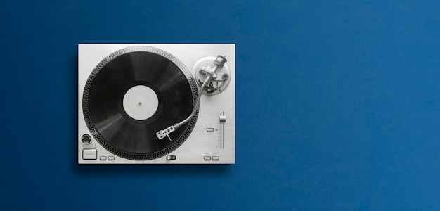 A top view of a classic record player flat lay, simple minimalism concept wit copy space