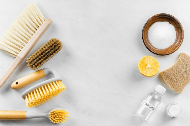 Top view of cleaning brushes with baking soda and lemon
