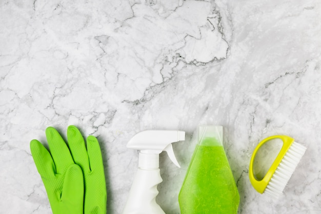 Top view cleaning items on marble table