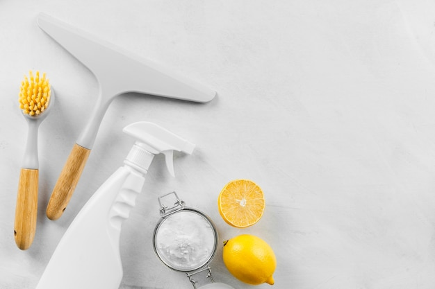 Top view of cleaning products with baking soda and lemon