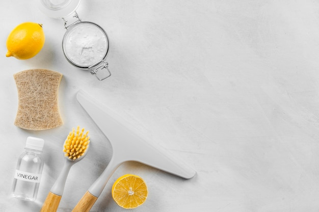 Top view of cleaning products with lemon and baking soda