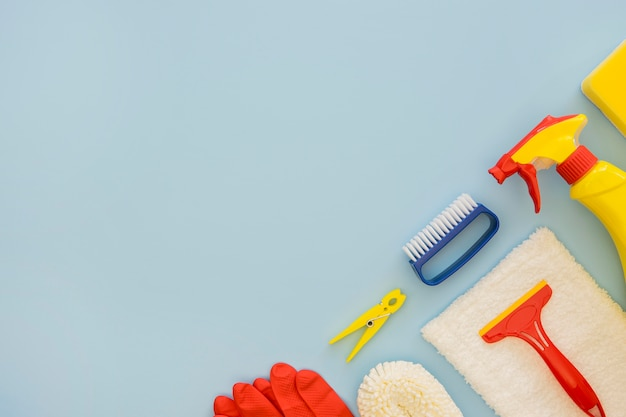 Top view cleaning supplies with copy space
