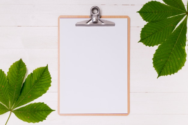Top view clipboard mock-up with leaves