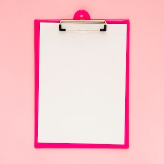 Top view of clipboard mock-up with pink background