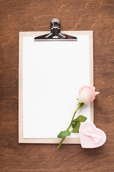 Top view clipboard with pink rose and gift