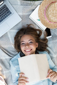 Top view close up of a happy young teenage girl laying