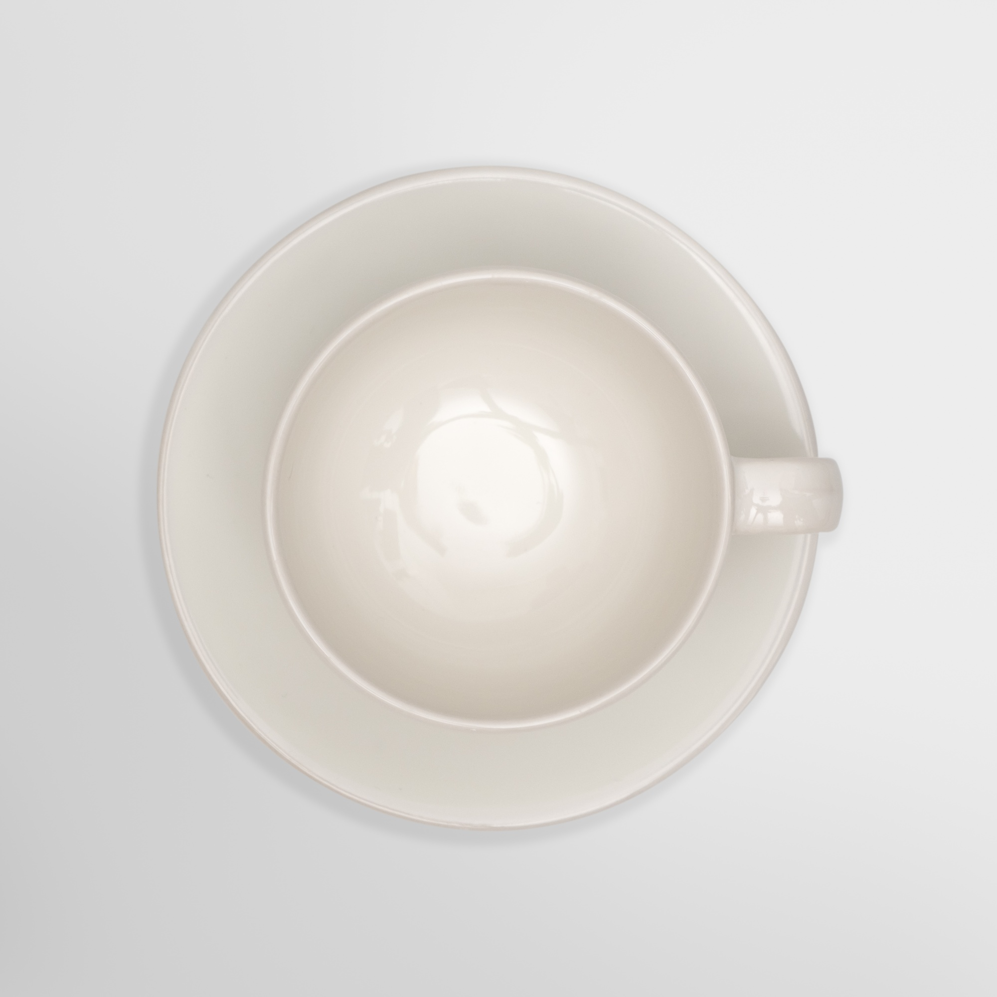 Top view-close up of a white cup on white background