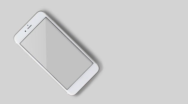 화면에 빈 모형이 있는 최신 스마트폰의 상위 뷰 클로즈업. 회색 색상의 배경에 고립.