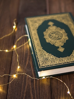 Top view closed quran with lights