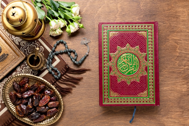 Top view closed quran on wooden background