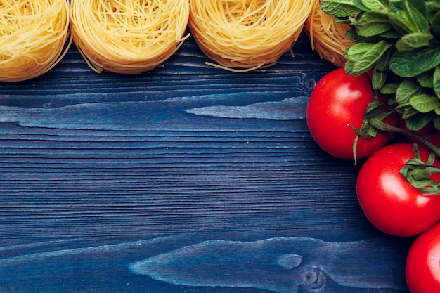 Top view closeup detail of tagliatelle italian pasta background