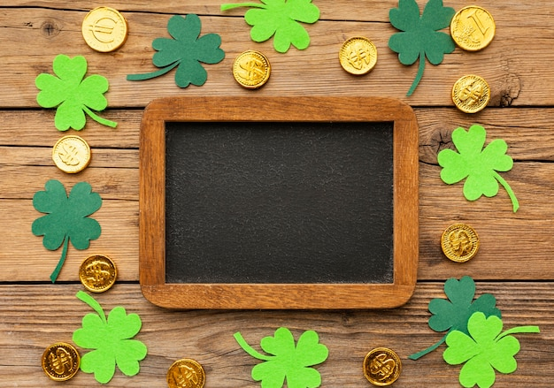Top view clovers, coins and frame arrangement