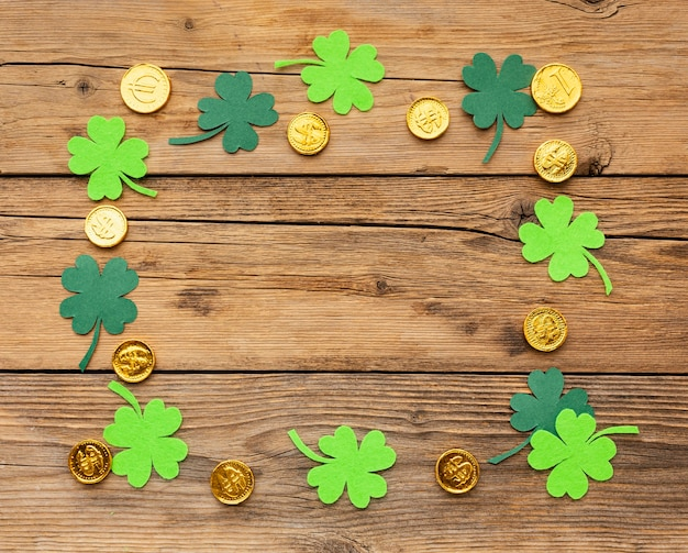 Top view clovers and gold coins arrangement