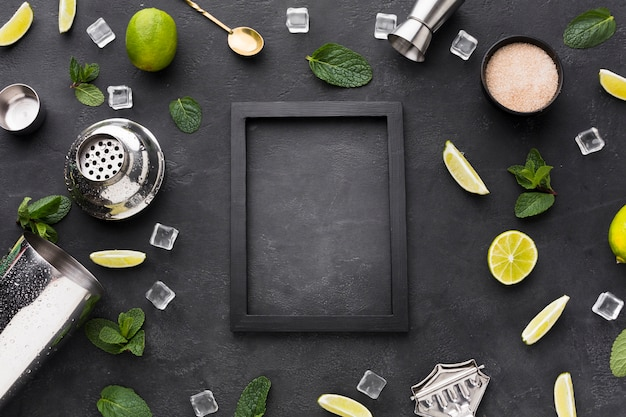 Top view of cocktail essentials with frame and mint