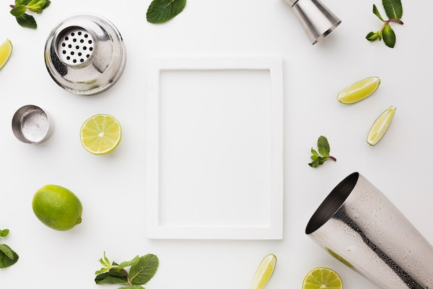 Top view of cocktail ingredients with shaker and frame