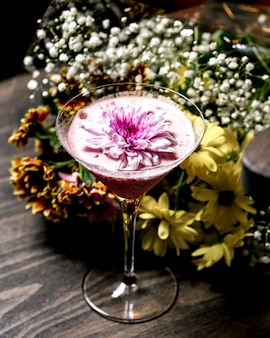 Top view of cocktail with flower on top in martini glass
