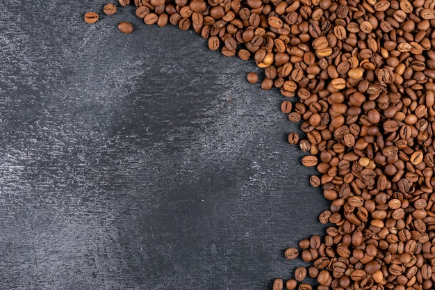 Top view coffee beans on dark surface