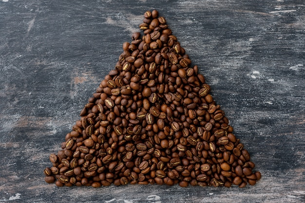 Top view of coffee beans in the form of triangle