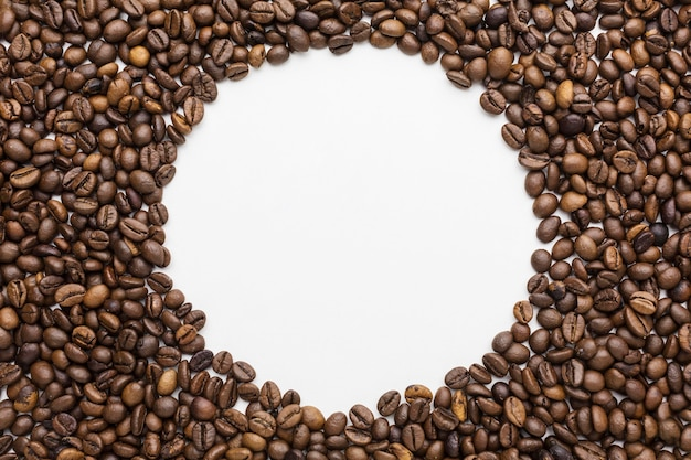 Top view of coffee beans frame with copy space
