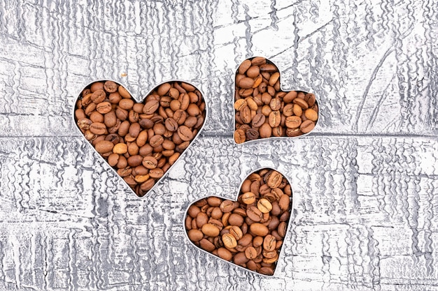 Top view coffee beans heart shape on retro surface