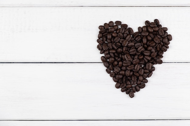 Top view of coffee beans in heart shape