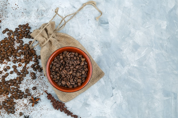 Top view coffee beans and spices on grunge background
