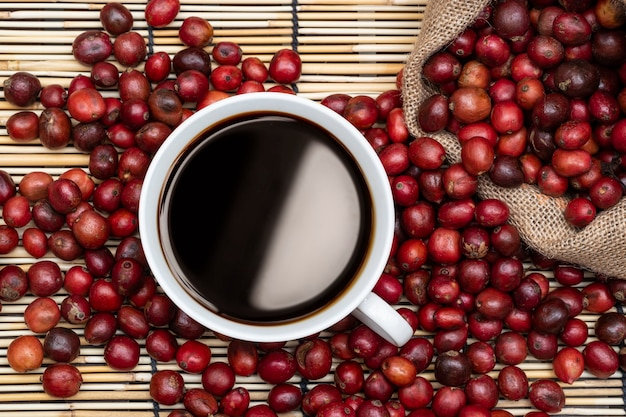 Top view of coffee cup and cherry coffee