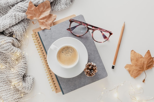 Top view coffee cup and glasses on agendas