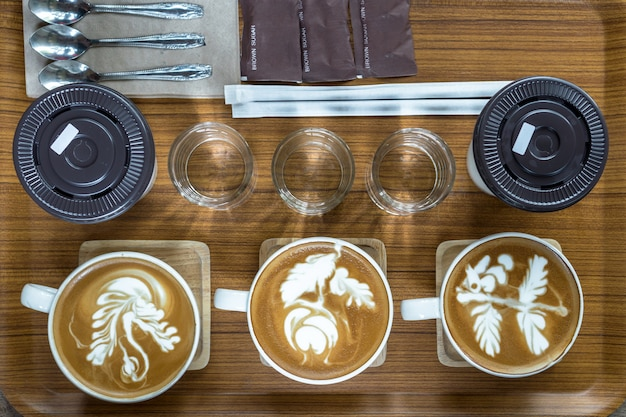 Top view of coffee cup set which consist of latte art