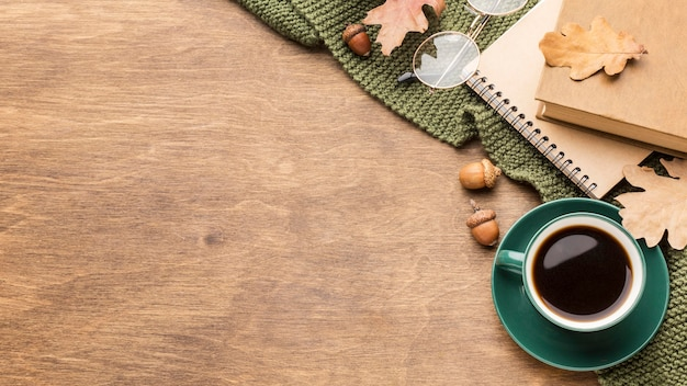 Top view of coffee cup with autumn leaves and copy space