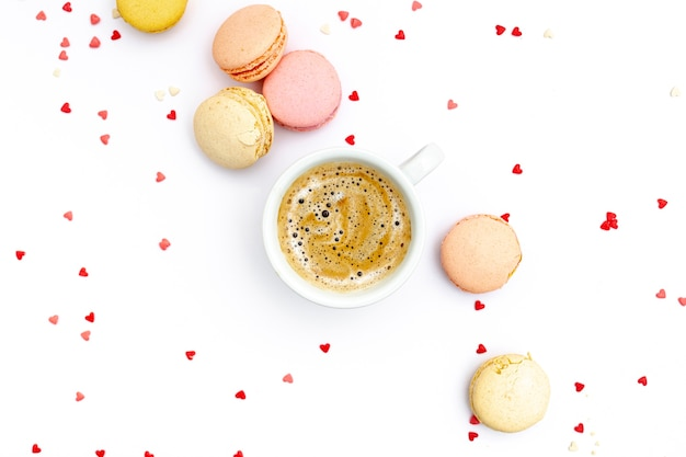 Top view of coffee cup with macarons for valentines day