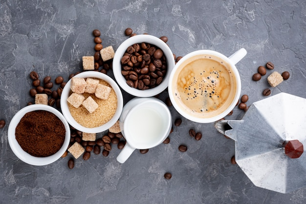 Top view of coffee cups and beans