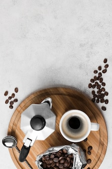 Top view coffee grinder with fresh hot beverage and copy space