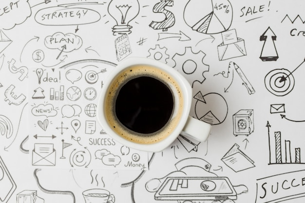 Top view coffee on papel full of doodles