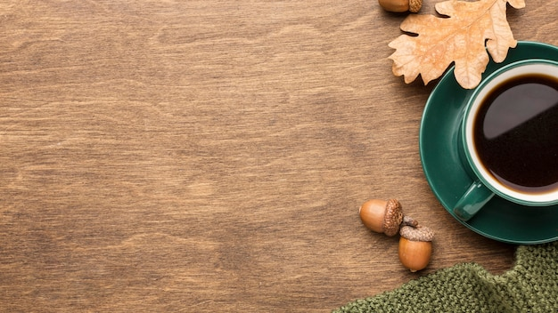 Top view of coffee with autumn leaves and copy space