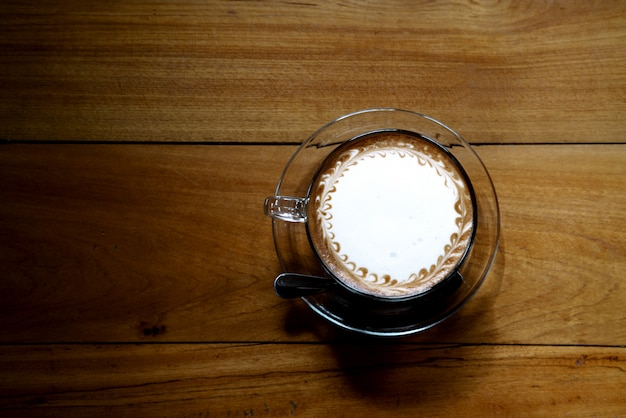 Top view of coffee on wooden table