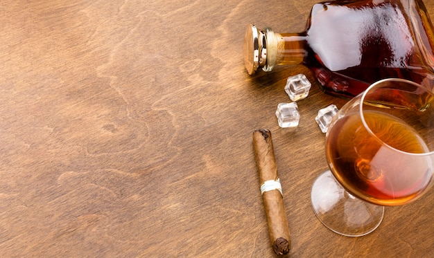 Top view cognac and cigar with copy space