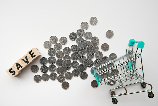 Top view coins with word and shopping cart