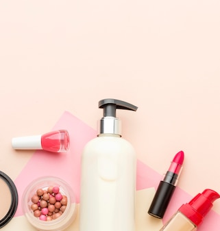 Top view collection of beauty products with copy space