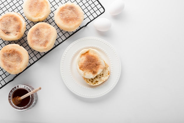 Top view collection of bread rolls next to eggs