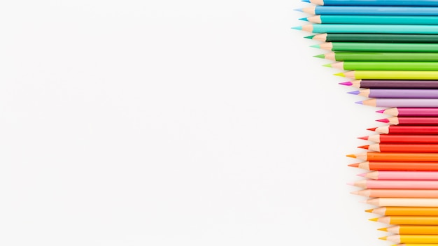 Top view collection of colourful pencils with copy space