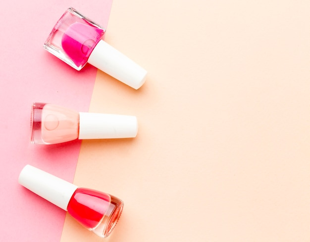 Top view collection of nail polish with copy space