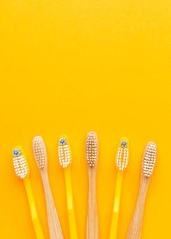 Top view collection of organic toothbrushes with copy space