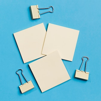 Top view collection of paper clips with sticky notes