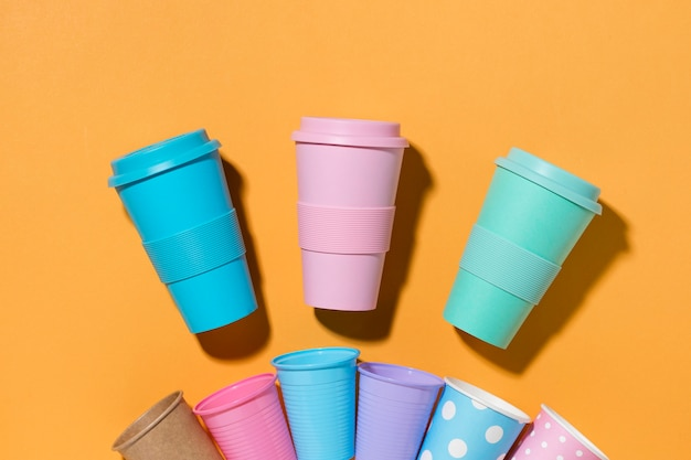 Top view collection of plastic cups on the table