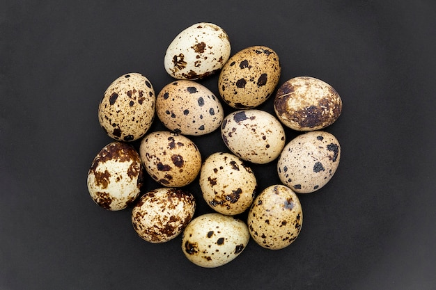 Top view collection of quail eggs on the table