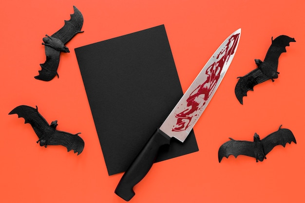 Top view collection of spooky halloween bats with knife