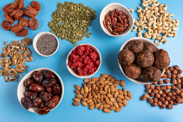 Top view of collection of superfoods in bowls